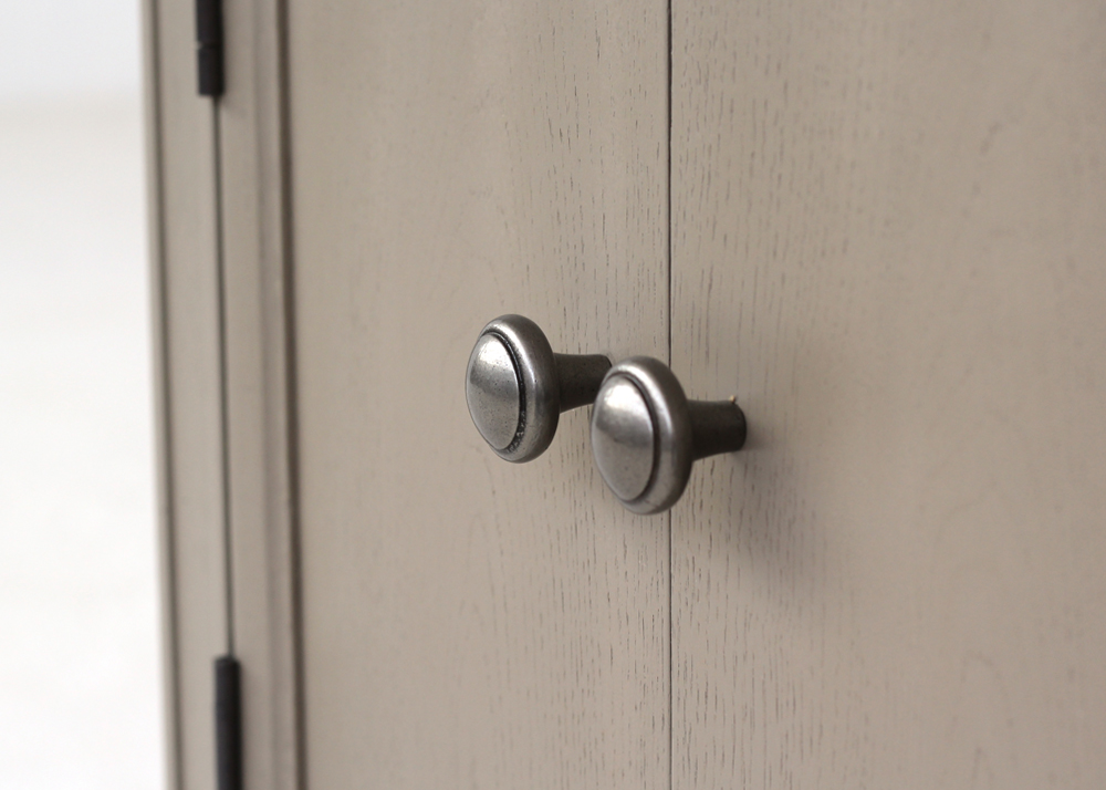 elegant pedestal cabinet handle detail